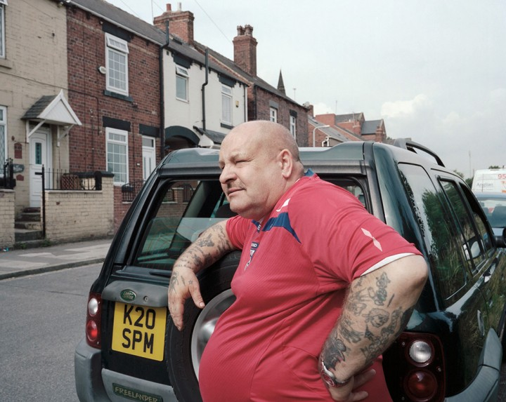 Former miner Spud Marshall (Darfield Main Pit) standing in front of his sold house on Rimington Road in Wombwell, Barnsley, South Yorkshire, 2013